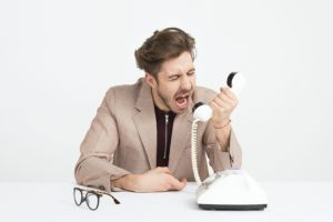 angery man on the phone upset but he is trying to call a houston counselor to learning coping skills